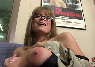 Enchanting solo model pornstar in glasses displaying her fake tits