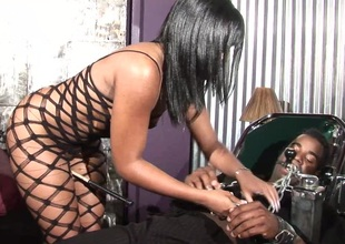 Alluring brunette in darksome fishnet getting her anal fucked hardcore doggy style