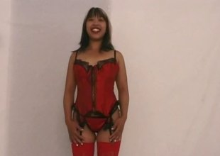 Corset and red stockings on the bent over anal slut