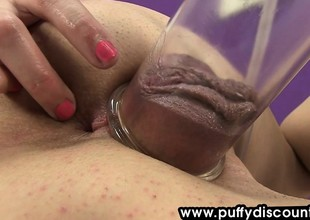 Horny girl widens her legs and uses pump