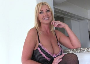 Experienced blonde in stockings shows her huge boobs and the cunny