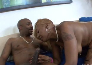 Huge bodied tattooed dark dude with white brunette having it doggystyle.