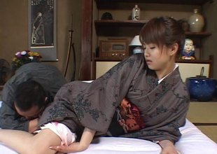 Japanese babe in the traditional clothes goes wild with the partner