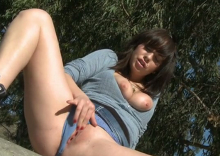 Lecherous bitch with lengthy legs Mindy Lynn rubs her pussy outdoors