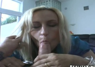 Golden-haired receives a mouthful of boner in blowjob action with hot fellow