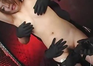 Naked Oriental woman chained up and screwed
