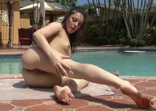 Brunette Nikki Lavay with small tities and hairless beaver is ready to pose naked and play with herself all day long