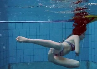 Underwater with a bikini girl stripping in the pool
