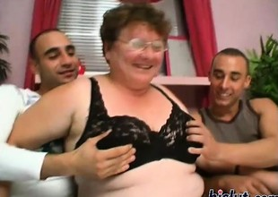 Foxy granny receives hammered by two youthful shafts