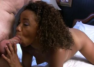 Curly-haired Ebony Michelle Brown acquires a white rod